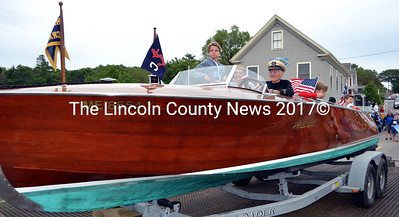 A Hacker-Craft boat gets a tow from the Bittersweet Landing Boatyard truck during the South Bristol centennial parade. (J.W. Oliver photo)