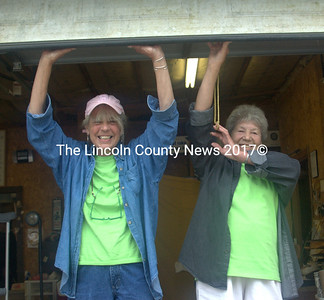 """Linda and Shirley, """"The Drop-Off Divas,""""  open the doors to welcome the shoppers to the Miles Memorial Hospital League Rummage Sale Saturday. Hospital league sales are held on the third Saturday of each month, until the weather gets too cold, usually in November. The doors open at 7 a.m. and the sale continues until noon. (Eleanor Cade Busby photo)"""
