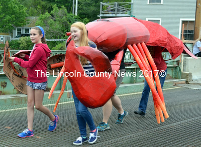 Emma Scott (left) and Nuala Glendinning lead a lobster through the South Bristol centennial parade. (J.W. Oliver photo)