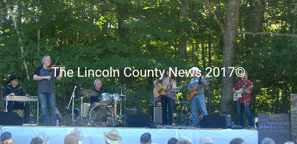 Debbie Myers and Redneck Rodeo play at North Nobleboro Day. Audience members arrived early to set up lawn chairs as Myers is a local favorite and has been entertaining at this event for over 10 years. (Eleanor Cade Busby photo)