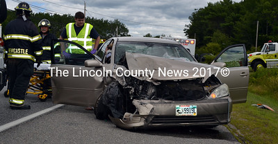 Ambulance and fire personnel assist a passenger after a collision on Route 1 in Newcastle Friday, Aug. 7. (J.W. Oliver photo)