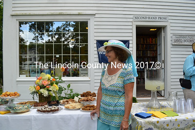 Mad Hatter Tea Party guest Sandra Shea stands by the refreshment table admiring the beautiful floral center piece designed by Michelle Beal, of Marianmade Farm. (Charlotte Boynton photo)