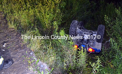 An all-terrain vehicle lies upside down in a ditch alongside Controversy Lane in Waldoboro Friday, Aug. 14. A 10-year-old and a 9-year-old were on the ATV at the time of the rollover, according to police. (J.W. Oliver photo)