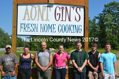 Aunt Gin's, the long-awaited restaurant in Whitefield, opened its doors for business on Aug. 10. Staff took a break from prepping the restaurant for dinner to pose for a picture Friday, Aug. 14. Pictured from left to right are John Dumas, Samantha Peaslee, Steve Dumas, Krystal Albert, Ashton Scott, Alex Dumas, and Austin Gardner. (Abigail Adams photo)