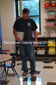 Great Salt Bay Community School Maintenance Supervisor Mark Hagar stands on one of the new linoleum floors installed at the school during the summer months. (Maia Zewert photo)