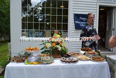 Wiscasset Selectman and Assistant Librarian David Cherry takes a break to have a cold drink during the Mad Hatter Tea Party Aug. 12. (Charlotte Boynton photo)