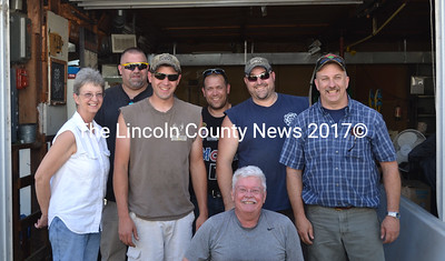 Coopers Mills Volunteer Fire Department Association members Dot Best, Josh Mooers, Jesse Barton, Charlie Ripley, Garrett Joslyn, Tim Yorks (from left to right), and David Landmann (in front) stand in the bay door of the Coopers Mills Fire Station on Friday, Aug. 14 preparing for the annual auction held on Saturday. Rehabilitation of the station will now begin and is scheduled to be complete by October. (Abigail Adams photo)