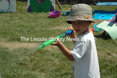 Brecken Sawyer concentrates during one of the kids games at Colonial Pemaquid during Olde Bristol Days. (Maia Zewert photo)