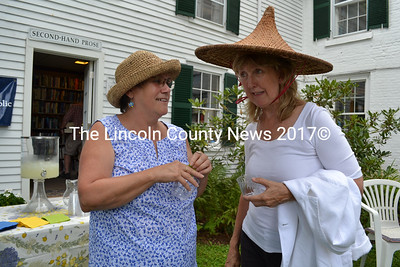 Wiscasset Selectman Judy Flanagan (left) and Terri Wells chat during the Mad Hatter Tea Party Aug. 12. (Charlotte Boynton photo)