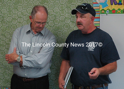 AOS 93 Supt. Steve Bailey, left, listens while Great Salt Bay Community School Maintenance Supervisor Mark Hagar, right, details some of the the summer renovations during a tour of the facilities at the Great Salt Bay School Board meeting Wednesday, Aug. 12. During the summer months, carpets in some of the classrooms were replaced with linoleum, and multiple teachers moved classrooms. (Maia Zewert photo)