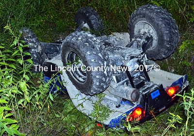 An all-terrain vehicle lies in a roadside ditch off Controversy Lane in Waldoboro Friday, Aug. 14. Two juveniles were transported to LincolnHealth's Miles Campus in Damariscotta after the accident. (J.W. Oliver photo)