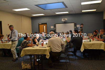 Two Bridges Regional Jail staff, Lincoln County officials, Jail Authority members, and friends gather to celebrate the retirement of Corrections Officer Sue Sutter Tuesday, Aug. 18. (Charlotte Boynton photo)