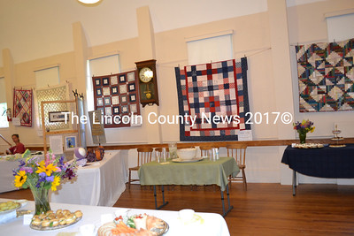 Quilts made by Westporters hang on the walls of Westport Island's historic town hall during the 60th anniversary reception for the Westport Community Association. (Charlotte Boynton photo)