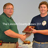 Lincoln County Fire Chiefs Association Vice President Walter Morris presents the Firefighter of the Year Award to Allen Spinney during the association's annual meeting and lobster bake at the South Bristol Fire Department Aug. 19. (J.W. Oliver photo)