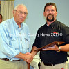 Jack Brackett (left) accepts the Chief Bob Maxcy Lifetime Achievement Award from Lincoln County Fire Chiefs Association President Neil Kimball during the association's annual meeting and lobster bake at the South Bristol Fire Department Aug. 19. (J.W. Oliver photo)