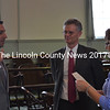 District Attorney Geoff Rushlau stands witness as new Assistant District Attorney Matthew Kanwit (left) is sworn in by Lincoln County Deputy Administrator Debbie Tibbetts in Lincoln County Superior Court Friday, Aug. 21. (Abigail Adams photo)