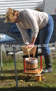 Jeanette Wheeler operates a small cider press during the Bremen Country Fair. (Alexander Violo photo)