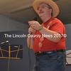 Nobleboro Applefest Master of Ceremonies Mitchell Wellman reads off a door prize winner. (Alexander Violo photo)