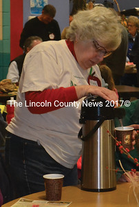 Nobleboro Historical Society President Mary Sheldon serves coffee during the AppleFest. (Alexander Violo photo)