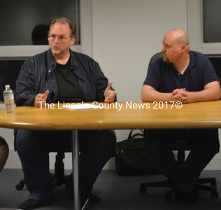 Chrys Hearth (left) discusses ongoing efforts to reopen the Waldo Theatre as Corey Honkonen (right) looks on during an informal meeting at the Waldoboro Town Office Oct. 6. (Alexander Violo photo)