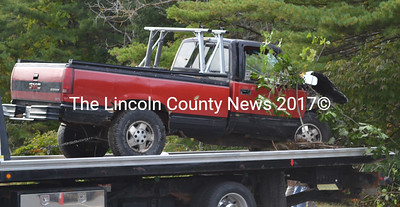 An excavator was needed to remove a 1990 GMC Sierra that hit a DOT road sign and several trees before coming to a rest on its side several feet off the road on Route 1 in Wiscasset Oct. 1. The accident is thought to have occurred between 1 a.m. and 3 a.m. on Sunday, Sept. 27 but was not reported until Thursday, Oct. 1 when the owner called Wiscasset police asking where they had towed his car. (Abigail Adams photo)