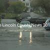 A Volkswagen Beetle braves floodwaters in Damariscotta's municipal parking lot Sept. 30. (Maia Zewert photo)