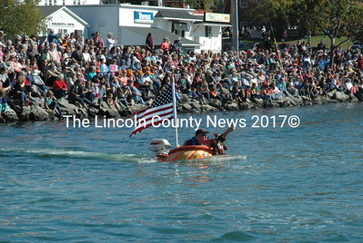 Jeff Dutra forges ahead despite taking on water during the pumpkinboat regatta held in Damariscotta Harbor Oct. 12. (Maia Zewert photo)