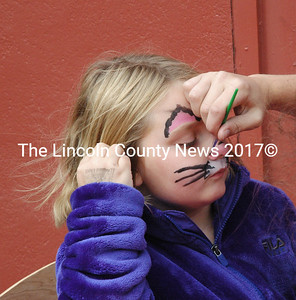 Aubrey Prock, of Jefferson, holds still while having her face painted Saturday, Oct. 10. The Damariscotta Pumpkinfest and Regatta offered various activities and entertainment for all ages. (Maia Zewert photo)