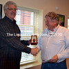 Lincoln County News Publisher Chris Roberts (left) presents longtime LCN sales representative Ernie Card with a watch on the occasion of his retirement. Card is retiring after more than 20 years with the newspaper. (J.W. Oliver photo)