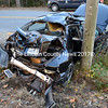 A 2000 Nissan Maxima rests against a utility pole at the corner of Boothbay Road (Route 27) and Eddy Road in Edgecomb after a collision with a Maine Department of Transportation dump truck Friday afternoon, Oct. 30. (J.W. Oliver photo)