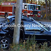 Lincoln County Sheriff's Office Lt. Rand Maker looks inside a 2000 Nissan Maxima after a collision between the car and a Maine Department of Transportation dump truck at the intersection of Boothbay Road and Eddy Road in Edgecomb Friday afternoon, Oct. 30. (J.W. Oliver photo)