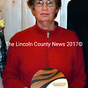 Mobius Inc. Adult Case Manager Kathy Cooper accepts an award in recognition of 25 years of service during the agency's annual meeting at The 1812 Farm in Bristol Mills Monday, Nov. 9. Cooper also received the agency's Dedicated Community Member Award. (J.W. Oliver photo)