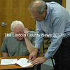 Damariscotta Town Manager Matt Lutkus points out part of the town's site plan review ordinance to board of appeals member Doug Morton before the board's meeting Friday, Nov. 6. The meeting was called to discuss a request for administrative appeal from Maine-ly Pawn owner Mark Hoffman. (Maia Zewert photo)