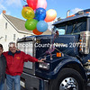 Bill Perkins (left) stands with Yankee Pride Transport owner Larry Sidelinger next to a Western Star truck in Damariscotta Saturday, Nov. 14. Sidelinger bought the truck to recognize Perkins for logging his 4 millionth mile as a truck driver. (J.W. Oliver photo)