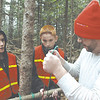 Great Salt Bay Assistant Principal Ira Michaud, right, teaches the proper way to tie two ropes together as Nathan Fraser, left, and Cason Gifford look on. (Maia Zewert photo)