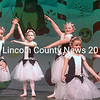 """Young dancers perform """"The Mistletoe Waltz."""" In alphabetical order: Olivia Ball, Grace Bryant, Acadia Dinsmore, Lucy Himes, Hailey Hobbs, Lillian Labrie, Sarah Prior, and Renee Ripley. (Eleanor Cade Busby photo)"""