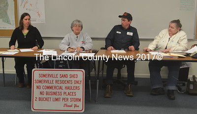 From left: Somerville Town Clerk Kelly Payson-Roopchand and Selectmen Susan Greer, Don Chase, and Darlene Landry sit behind a new sign for the town's new sand shed. (Alexander Violo photo)