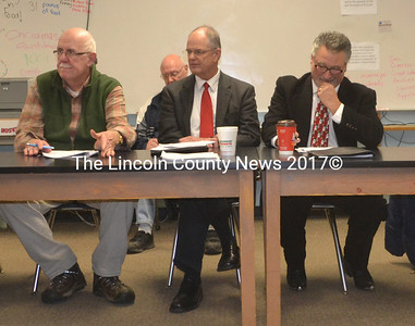 AOS 93 Superintendent Steve Bailey (center) delivers his report to the AOS 93 Board while Al Vorhis of Jefferson (left) and Board Chair Bruce Farrin. Jr., of South Bristol look on during their meeting at the Great Salt Bay Community School in Damariscotta Dec. 15. (Alexander Violo photo)
