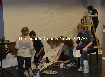 Medomak Valley High School students in Storybook Theater paint a backdrop for their set on Monday, Dec. 14. (Alexander Violo photo)