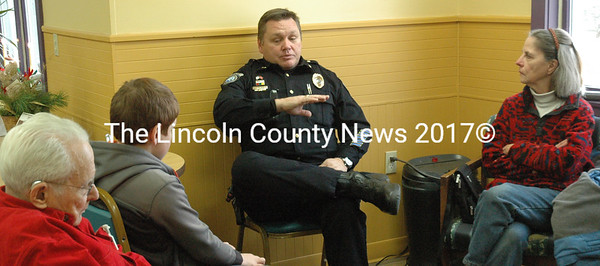 Damariscotta Police Chief Ron Young addresses a group of community members during the Coffee with a Cop event held Dec. 21 at Spectrum Generations. Young said he hopes to have more events like this in the future to better connect the police department with the community. (Maia Zewert photo)