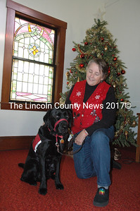 Pastor Kelly Harvell and Benny the ministry dog have been working together since 2012. Benny sits by the pulpit Sunday mornings while Harvell preaches at Round Pond and New Harbor Methodist churches and accompanies her on visitation. (Maia Zewert photo)