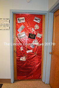 Wiscasset's front-office staff decorated their door with candy canes and Christmas cards to greet people as they enter the town office. (Charlotte Boynton photo)