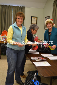 Wiscasset volunteers check their list twice to ensure the fulfillment of children's Christmas wishes Sunday, Dec. 20. From left: Sue Varney, Wiscasset Selectman Judy Flanagan, and Wiscasset Administrative Assistant Kathy Onorato. (Charlotte Boynton photo)
