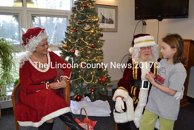 Santa and Mrs. Claus listen to Karlie, of Dresden, as she tells Santa her wishes for Christmas during the breakfast with Santa event at the Wiscasset Senior Center on Saturday, Dec. 19. (Charlotte Boynton photo)