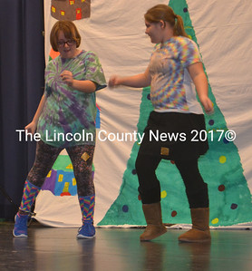 Halie Winchenbach and Sarah Robinson perform during the talent show at Jefferson Village School Dec. 18. (Alexander Violo photo)