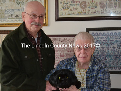 Doc and Nancy Schilke with their dog Oliver in their Boothbay Harbor home Dec. 21. (Abigail Adams photo)