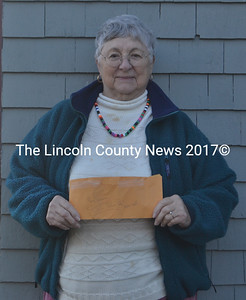 Natalie House, of Damariscotta, holds a $200 anonymous donation she received to buy gifts for a boy while she was collecting funds for a food pantry drive. (Alexander Violo photo)