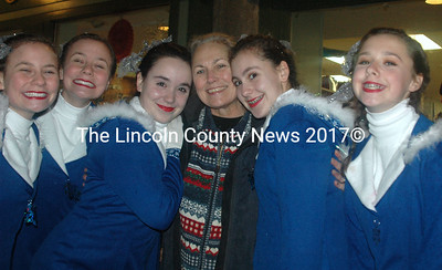 Renys Rockets high-kicked in the pouring rain and never lost their smiles. Here they thank their teacher, Midcoast Dance Studio owner  Faye Cain with a hug. Shown from left to right, Kayleigh Tolley, Katherine Tolley, Alexia Hilt, Faye Cain, Shelby Lash, and Ivy Laakso. (Eleanor Cade Busby photo)