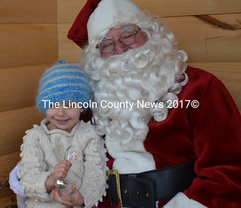 Tabitha McGregor giggles during her visit with Santa at the Wiscasset, Waterville & Farmington Railway's Alna Station Saturday, Dec. 19. (Abigail Adams photo)