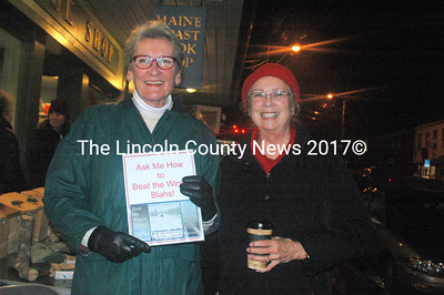 "Marva Nesbit and Toni Crouch were determined to help folks beat the winter blahs at ""Wrap it Up"" last Thursday in Damariscotta. They passed out lists of locations featuring special offers and discounts for the many savvy shoppers who came out on the rainy night. (Eleanor Cade Busby photo)"
